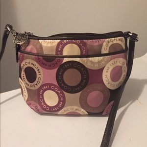 Beautiful purple colored coach cross body bag